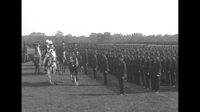 prince of wales and lord byng, commissioner of police, ride horses in front of company of police standing in formation / they ride around to other... - 1920 1929 video stock e b–roll