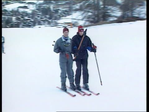 prince of wales and sons skiing holiday itn klosters ext prince charles and prince william along towards on drag lift prince harry and cousin zara... - ski holiday stock videos & royalty-free footage