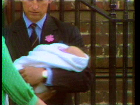 biography serialised tx london st mary's tms prince of wales standing holding new baby prince william with princess of wales standing next cms... - biography stock videos & royalty-free footage