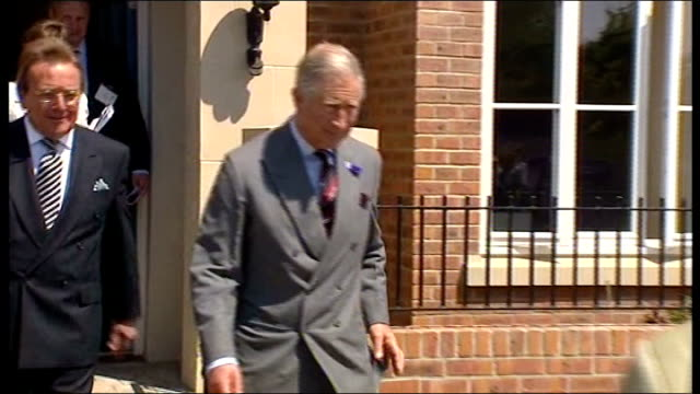 prince of wales criticised over chelsea barracks intervention wales llandarcy coed darcy ext prince charles departing new build house and chatting... - barracks stock videos and b-roll footage