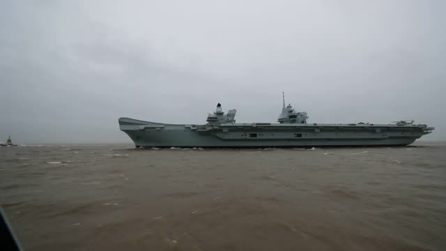 prince of wales sails towards liverpool ahead of a week-long visit to the city. it is one of two aircraft carriers used by the royal navy. - aircraft carrier stock videos & royalty-free footage
