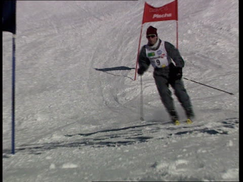 prince of wales skiing holiday switzerland klosters ms prince charles skiing down hill in slalom race pan - slalom skiing stock videos & royalty-free footage