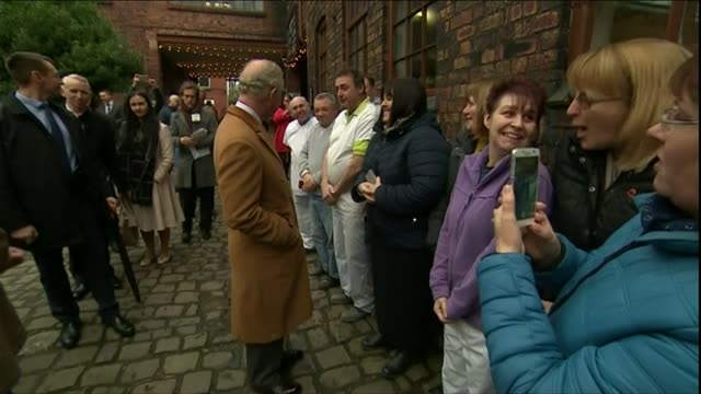 Prince of Wales visits Middleport Pottery ENGLAND Staffordshire StokeonTrent Middleport Pottery Prince Charles arriving at pottery and shaking hands...