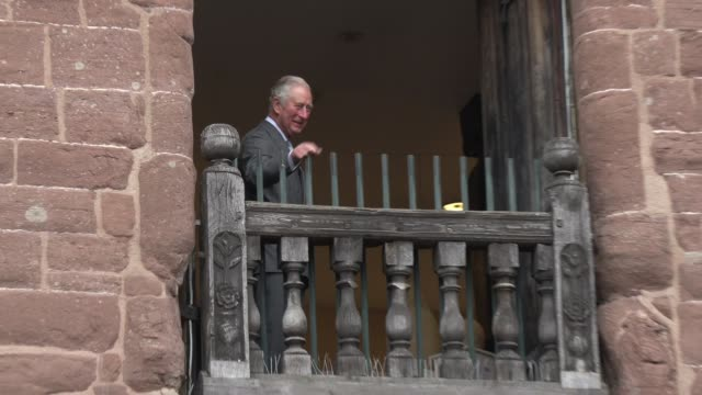 prince of wales waves from the balcony of the market hall during a visit to ross-on-wye where he will officially launch the gilpin 2020 festival on... - britisches königshaus stock-videos und b-roll-filmmaterial