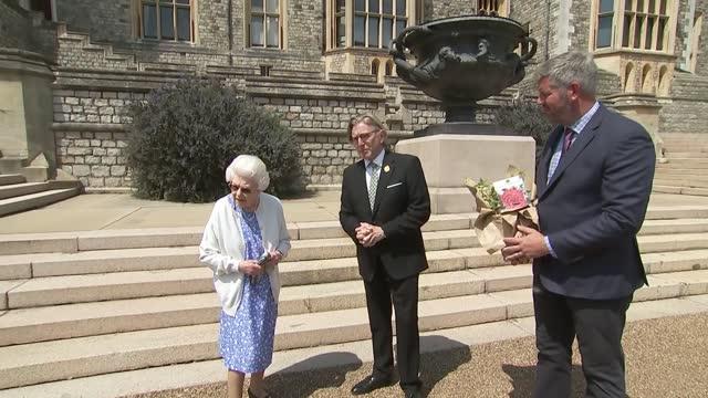 prince philip 100th birthday: queen elizabeth ii presented with rose; england: berkshire: windsor: east terrace garden: queen elizabeth ii meeting... - royal horticultural society stock-videos und b-roll-filmmaterial