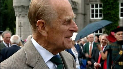 prince philip admitted to hospital after recurrence of bladder infection; lib - r07081201 / tx 7.8.2012 scotland: balmoral castle: gvs people outside... - blase harnapparat stock-videos und b-roll-filmmaterial