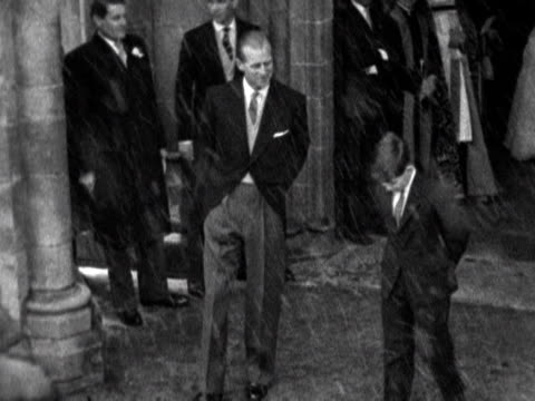 prince philip and prince charles leave romsey abbey following the wedding of lady pamela mountbatten to david hicks. 1960. - duke of edinburgh stock videos & royalty-free footage