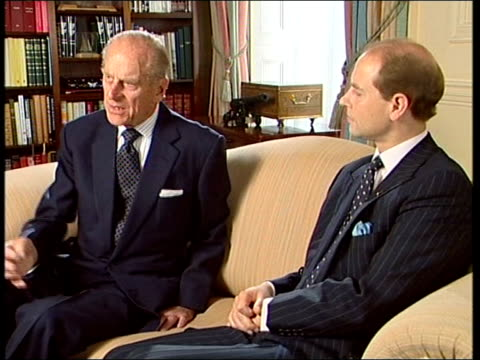 prince philip and prince edward interview on 50th anniversary of duke of edinburgh awards; england: london: buckingham palace: int tlms prince... - earl of wessex stock videos & royalty-free footage