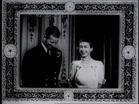 prince philip and princess elizabeth pose during their engagement announcement, princess margaret also joins in prince philip and princess elizabeth... - 1947年点の映像素材/bロール