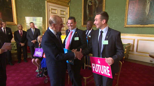 prince philip attends 500th duke of edinburgh gold award presentation ceremony at st james palace, presented with gift and jokes about feeling old - 2013 stock videos & royalty-free footage