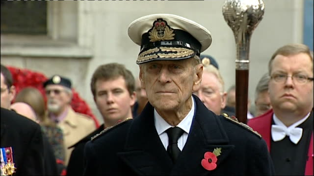 Prince Philip attends ceremony at Westminster Abbey Buglers playing as bells chime / Veterans and Prince Philip standing for minute of silence and...