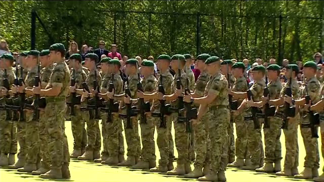 prince philip attends royal marines homecoming; royal marines stand to attention at national anthem 'god save the queen' played sot - royal marines stock videos & royalty-free footage