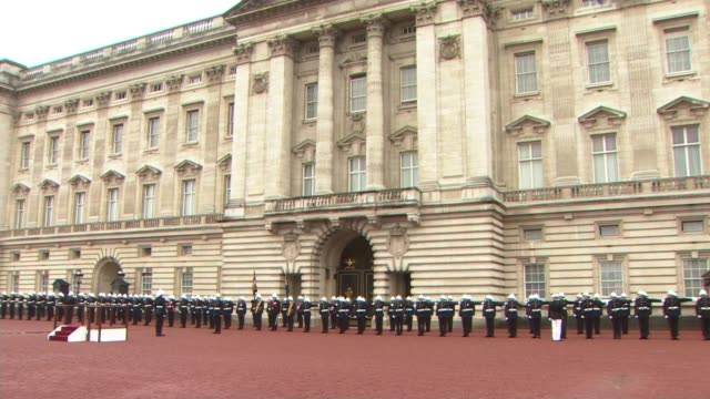 prince philip carries out last official public engagement: captain general's parade; england: london: buckingham palace: ext / raining royal marines... - carrying stock videos & royalty-free footage
