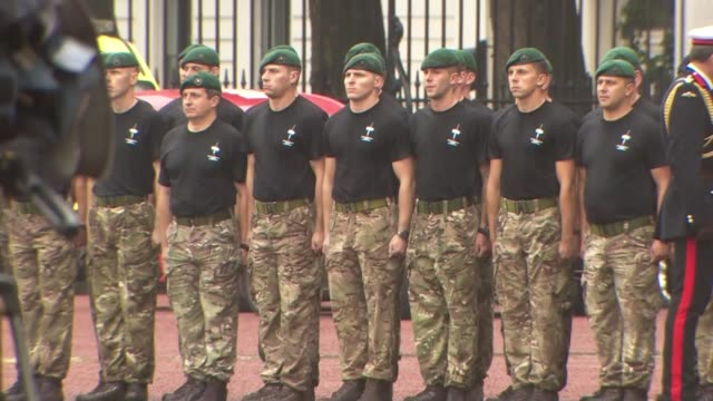 stockvideo's en b-roll-footage met prince philip carries out last official public engagement: captain general's parade; marines lined up as duke chats to them / duke poses with marines... - kadet