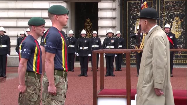 prince philip carries out last official public engagement captain general's parade close shots of marines gingell and thompson / close shots of... - lowering stock videos & royalty-free footage