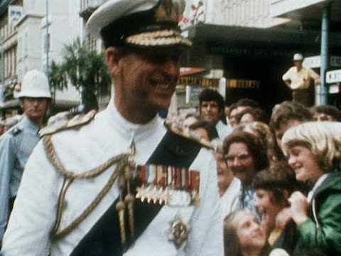 prince philip chats and laughs with the crowds during a walkabout in auckland during the queen's silver jubilee tour of new zealand 1977 - ロイヤルツアー点の映像素材/bロール