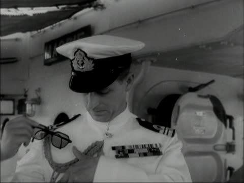 prince philip chats to an officer on board hms magpie 1950 - prince philip stock videos & royalty-free footage