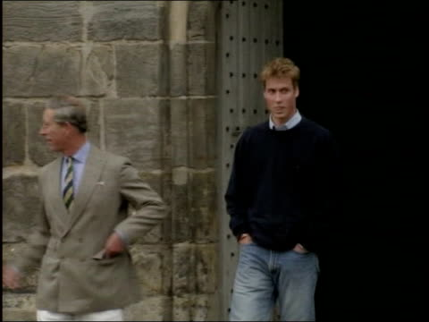 prince philip denies criticising prince william lib st andrews ext charles and prince william towards william shaking hands with wellwishers - 2001 stock-videos und b-roll-filmmaterial