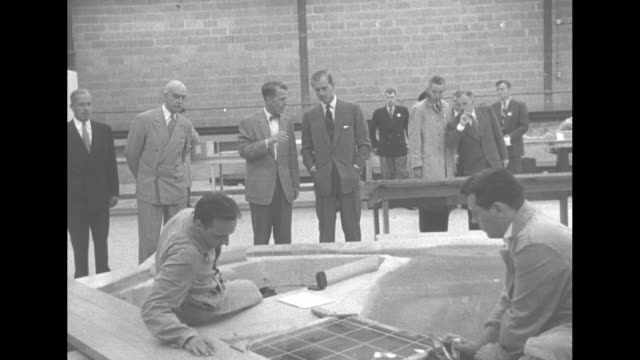 INT Prince Philip Duke of of Edinburgh inspects the model of the Saint Lawrence Seaway/ engineer puts drop of dark liquid into water to show...