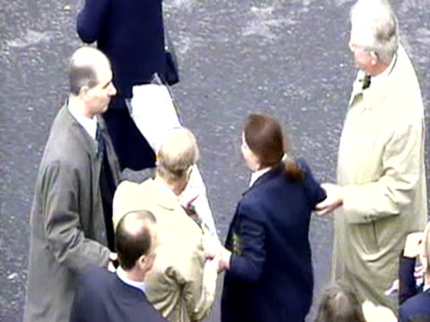 Prince Philip helps a teenage girl to jump over bannister to hand the Queen a bunch of flowers during her Golden Jubilee royal tour in Northern...