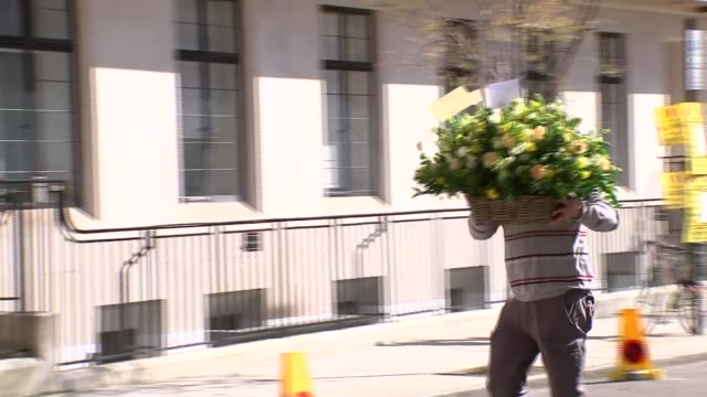 flowers delivered to king edward vii's hospital england london marylebone ext various of flowers and other gifts being delivered to the king edward... - メリルボーン点の映像素材/bロール