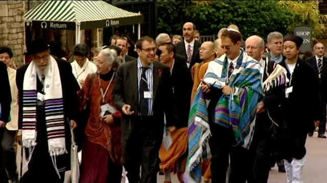 Prince Philip hosts Alliance of Religions and Conservation event ENGLAND Berkshire Windsor Windsor Castle EXT People along carrying banners bearing...