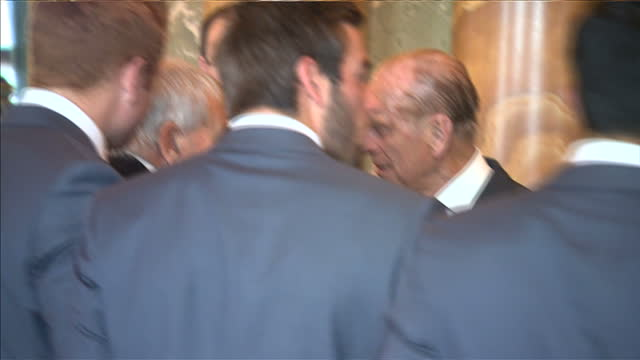 prince philip hosts awards ceremony for county cricket winners at buckingham palace. shows interior shots prince philip posing for photograph with... - squadra di cricket video stock e b–roll