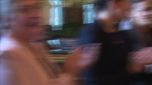 prince philip hosts cricket awards at buckingham palace. shows interior shots prince philip presenting awards to kent county cricket ladies team. at... - squadra di cricket video stock e b–roll