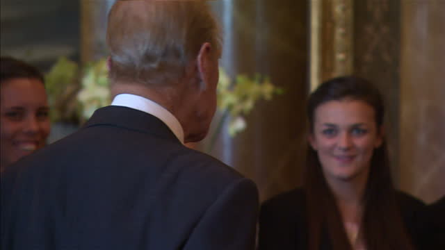 prince philip hosts event for yorkshire county cricket club in buckingham palace. shows interior shots prince philip walking into room and standing... - squadra di cricket video stock e b–roll