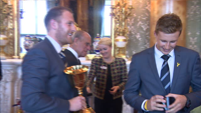 prince philip hosts event for yorkshire county cricket team at buckingham palace. shows interior shots prince philip presenting county championship... - squadra di cricket video stock e b–roll
