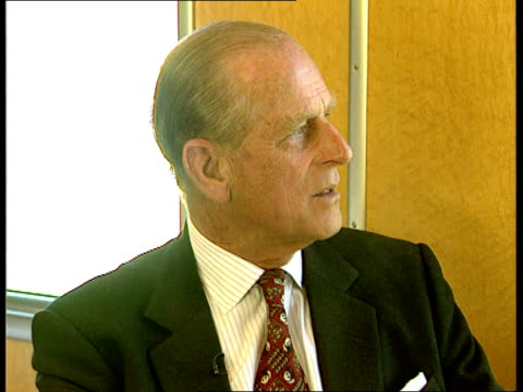 prince philip interview geneva ts people milling about at art exhibition reception bms prince philip looking at painting with woman painting of wild... - エジンバラ公爵点の映像素材/bロール