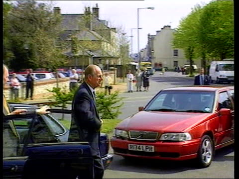 japanese emperor award row; prince philip: japanese emperor award row; c4n lib england: dorset: ext prince philip from car and shaking with men - 天皇点の映像素材/bロール