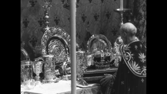 prince philip looks on at queen elizabeth ii's coronation ceremony in 1953 / st edward's crown is placed on the altar by dean of westminster / queen... - coronation of queen elizabeth ii stock videos and b-roll footage