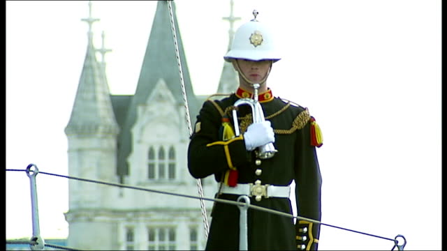 prince philip meets hms belfast veterans royal marine standing with bugle guns on deck royal marine playing last post on bugle sot - bugle stock videos and b-roll footage