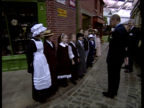 prince philip opens milestones museum in basingstone; england: hampshire: basingstoke: milestones museum: ext car along / prince philip, duke of... - duke of edinburgh stock videos & royalty-free footage