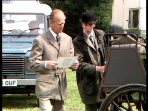 vídeos y material grabado en eventos de stock de prince philip prepares to compete in the windsor horse trials. - carruaje
