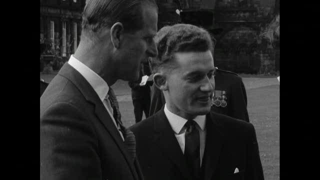 prince philip presents duke of edinburgh awards in garden of holyrood palace, 1965 - award stock videos & royalty-free footage