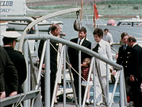Prince Philip Princess Anne and Prince Charles walk with Chay Blyth and his family from the Hamble quayside after becoming the first person to sail...