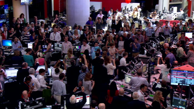 prince philip 'progressing satisfactorily' following exploratory surgery broadcasting house int queen being shown around bbc newsroom high angle wide... - bbc video stock e b–roll