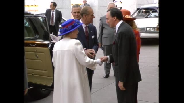 prince philip signs the visitors book / paul keating escorts queen out to the official state car / queen and prince philip bid farewell before... - queen royal person stock videos & royalty-free footage