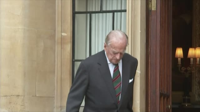 prince philip steps down as colonel-in-chief of the rifles; england: windsor: windsor castle: ext gv prince philip, duke of edinburgh along out of... - duke of edinburgh stock videos & royalty-free footage