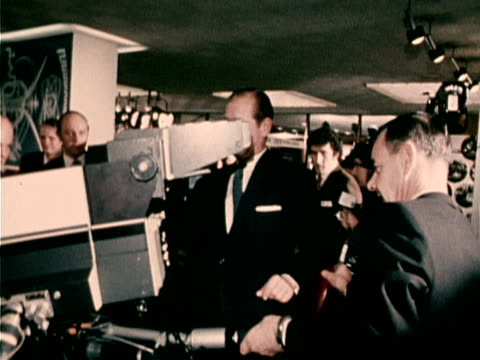vídeos de stock, filmes e b-roll de prince philip uses a television camera at an exhibition on broadcasting history at bbc broadcasting house 1972 - câmera de televisão