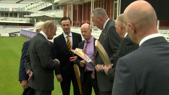 vídeos de stock, filmes e b-roll de prince philip visits lord's cricket ground to open the new warner stand england london st john's wood lord's cricket ground int prince philip duke of... - cortando fita