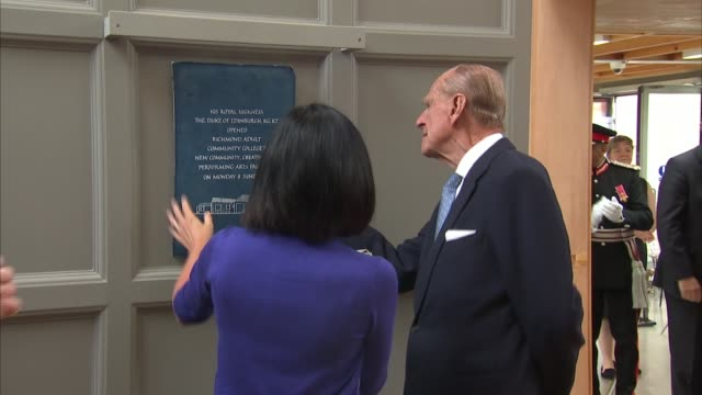 prince philip visits richmond adult community college prince philip unveiling plaque sot / speeches sot / prince philip receiving gift - plaques stock videos & royalty-free footage