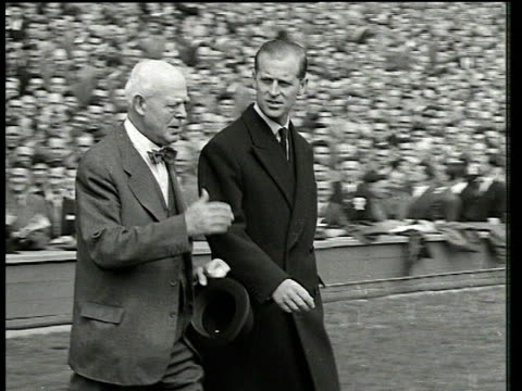 stockvideo's en b-roll-footage met prince phillip shaking hands with stanley matthews and rest of blackpool fc players blackpool fc vs bolton wanderers 1953 fa cup final wembley london - fa cup
