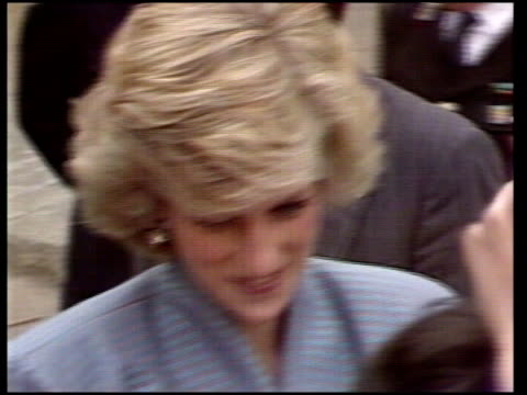 Prince Princess of Wales in Italy / Day 4 ITALY Milan MS Diana being greeted by officials as Charles out of car TMS Heads of crowd craning to see...