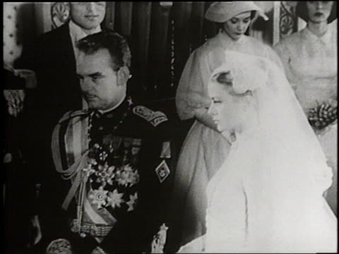 Prince Rainier and Actress Grace Kelly exchange vows at their wedding in Monaco in 1956