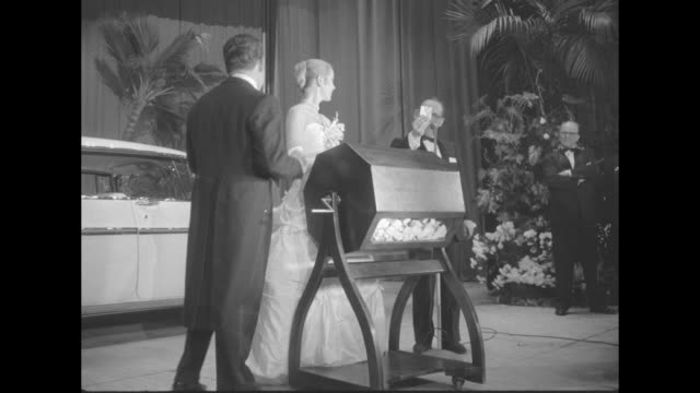 vídeos de stock, filmes e b-roll de prince rainier and grace kelly draw a raffle winner's name at the imperial ball a night in monte carlo charity event at the waldorfastoria the prize... - escolhendo