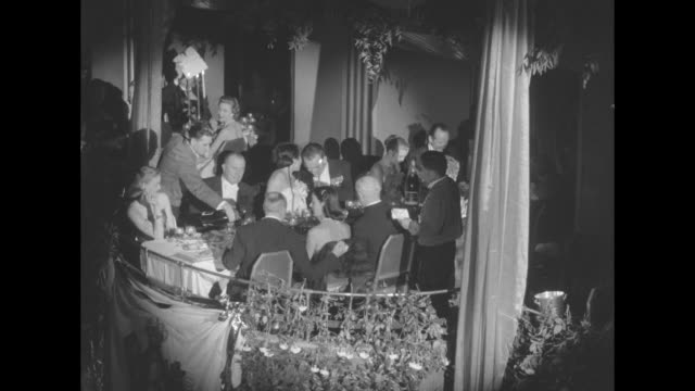 prince rainier and his fiancee grace kelly stand in the royal box at the imperial ball a night in monte carlo charity event at the waldorfastoria /... - grace kelly actress stock videos and b-roll footage