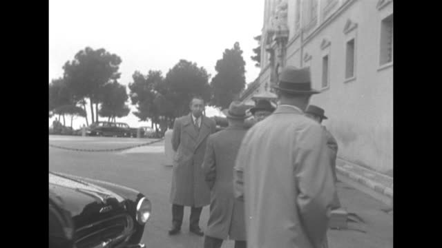prince rainier's chaplain father francis tucker exits his car and is escorted to the prince's palace - royal palace monaco stock videos and b-roll footage